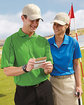 Extreme Ladies' Eperformance™ Velocity Snag Protection Colorblock Polo with Piping  Lifestyle